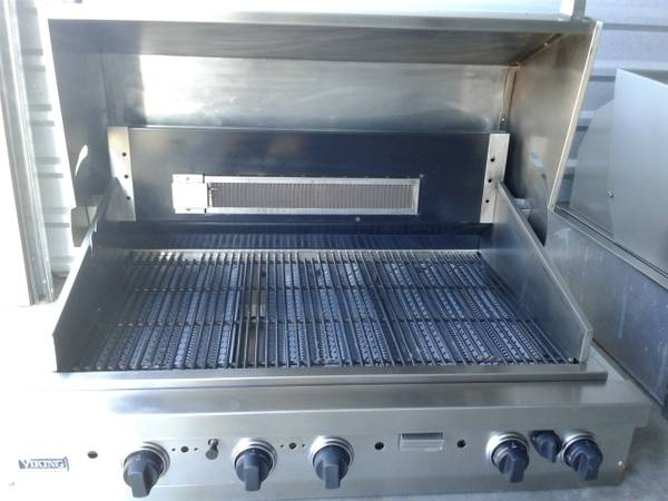 This is a stainless steel bbq grill that just got cleaned.